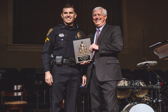 Corporal Paul Smilley receiving a youth leadership award from the District Attorney of Fayette County