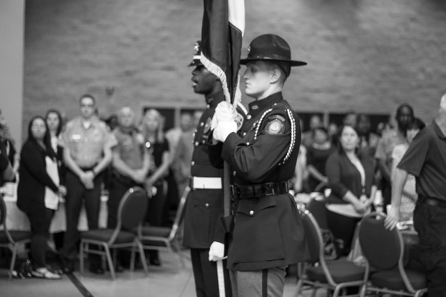 Cpl. Keith Isaac commanding the Honor Guard